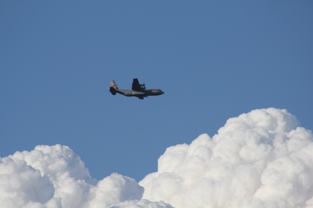 C-130 Against Smoke Clouds
